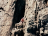 Allen Luck placing a bolt to abseil and escape. Super loose route, Hole in the Wall ~ 2002