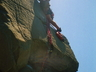 Derek Marshall climbing the pinnacle at Hole in the Wall ~ 2002