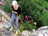 Learning the ropes at Masekane. Beginner doing her first abseil at Masekane.